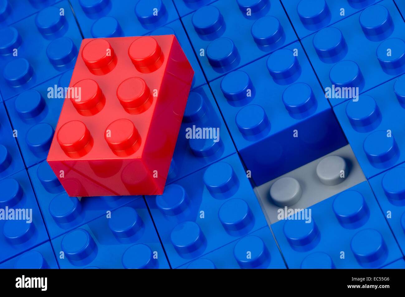 Unfitted red building block - Stock Image