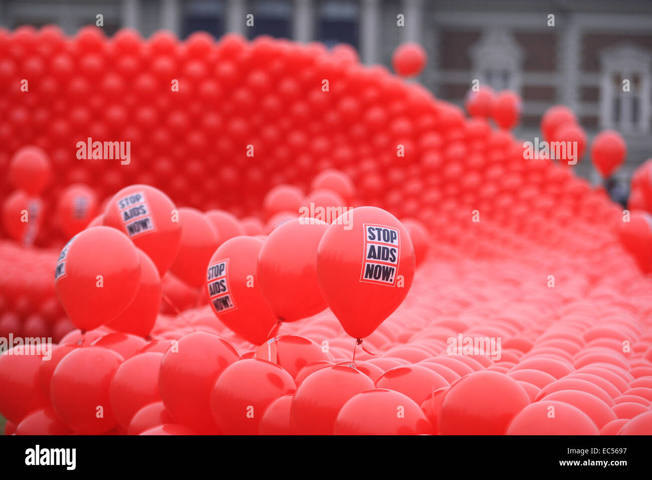 Red ribbon of the Dutch organization STOP AIDS NOW  during an awareness campaign to mark World AIDS Day at Museumplein - Stock Image