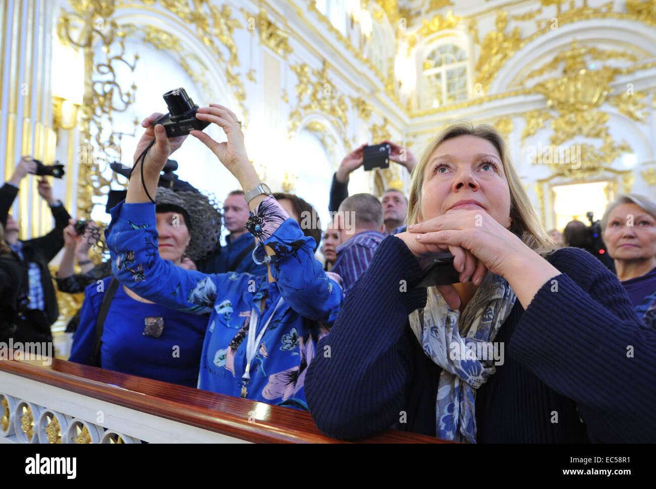 St. Petersburg, Russia. 9th Dec, 2014. Visitors at the opening of the renovated Grand Church of the Winter Palace. - Stock Image