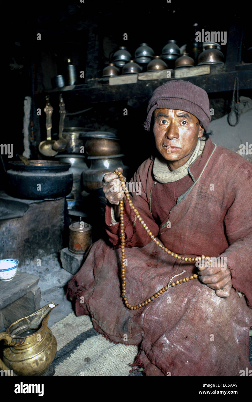 Tibet. Shaman/soothsayer sitting holding prayer beads. He is the lord Lonpo of Wanla.. - Stock Image