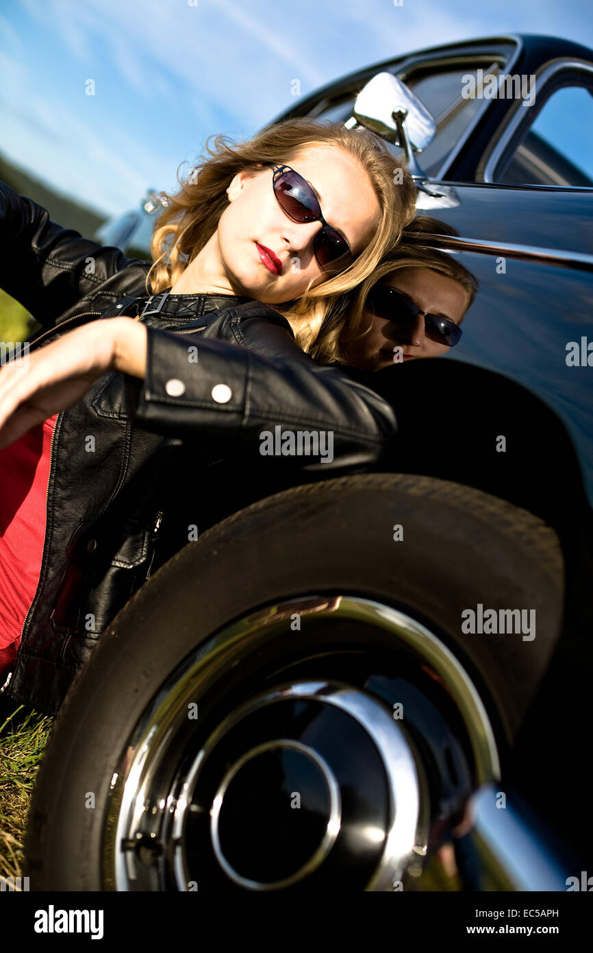 Girl in front of Post-War classic car - Stock Image