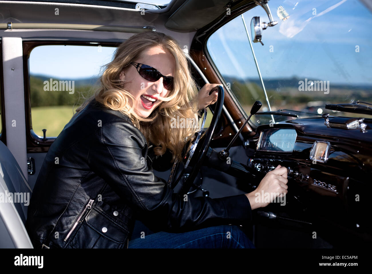 Girl inside of Post-War classic car - Stock Image