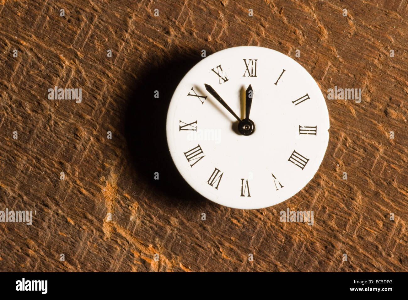 old watchface on rough wooden structure - Stock Image