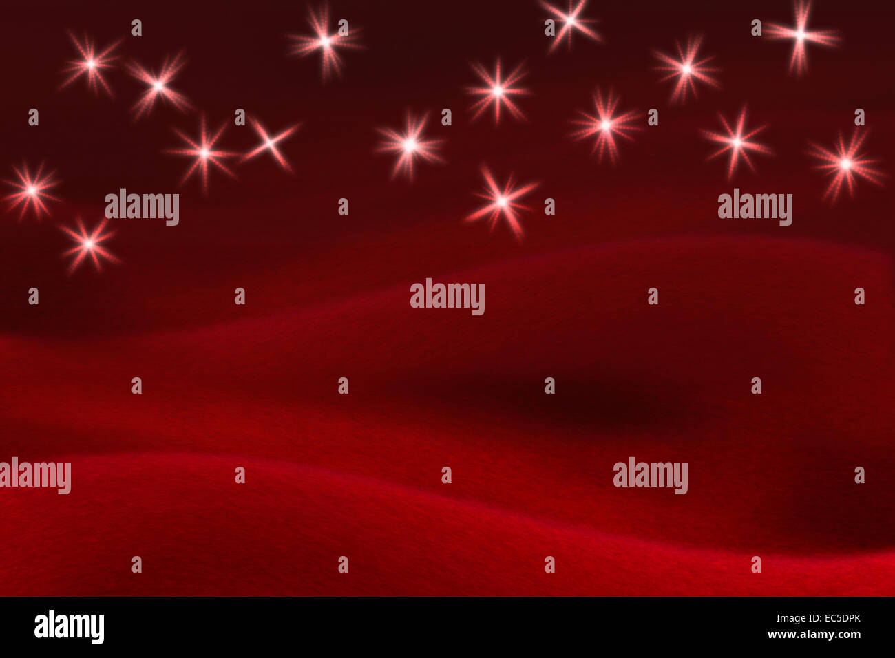 glittering stars on soft red background Stock Photo