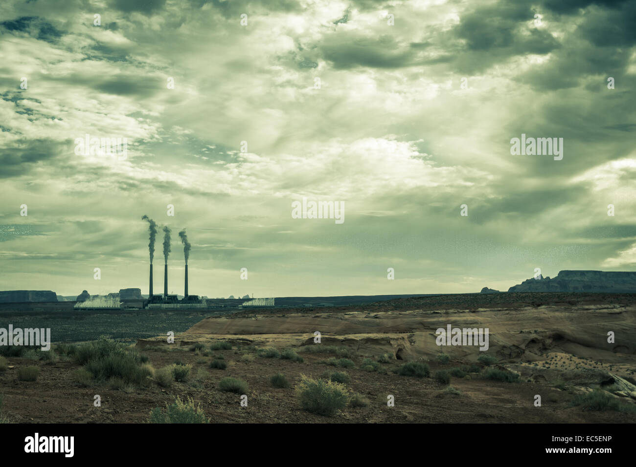 coal plant generating electricity with three large stacks polluting the environment - Stock Image