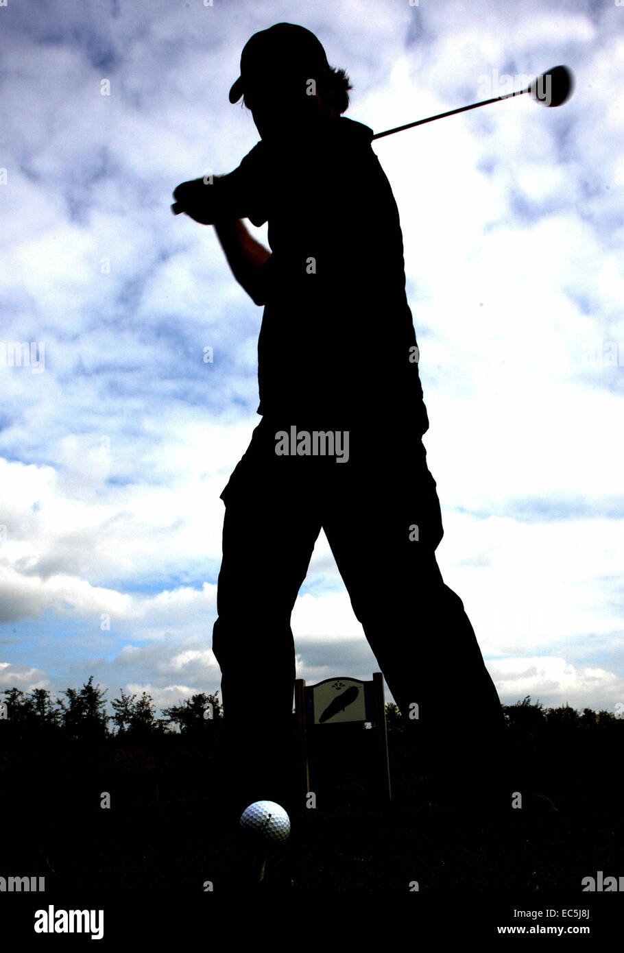 man hitting golfball - Stock Image