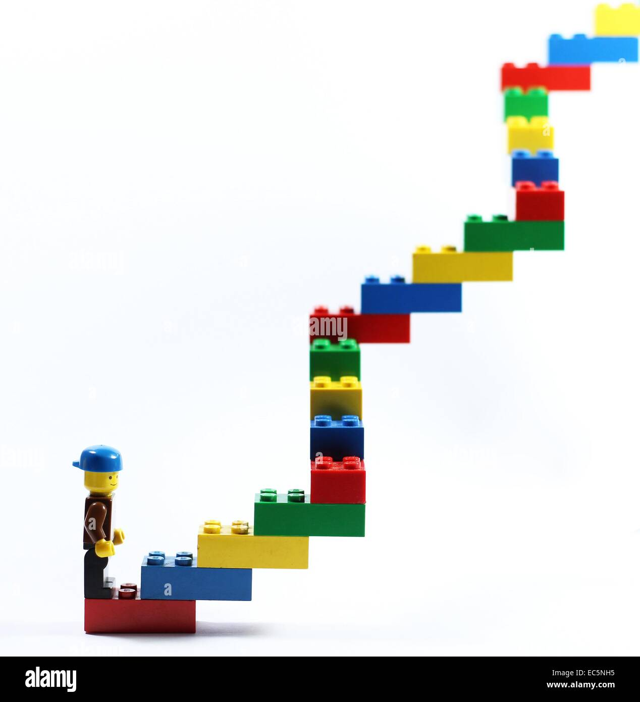 Lego figure and lego stairs. - Stock Image
