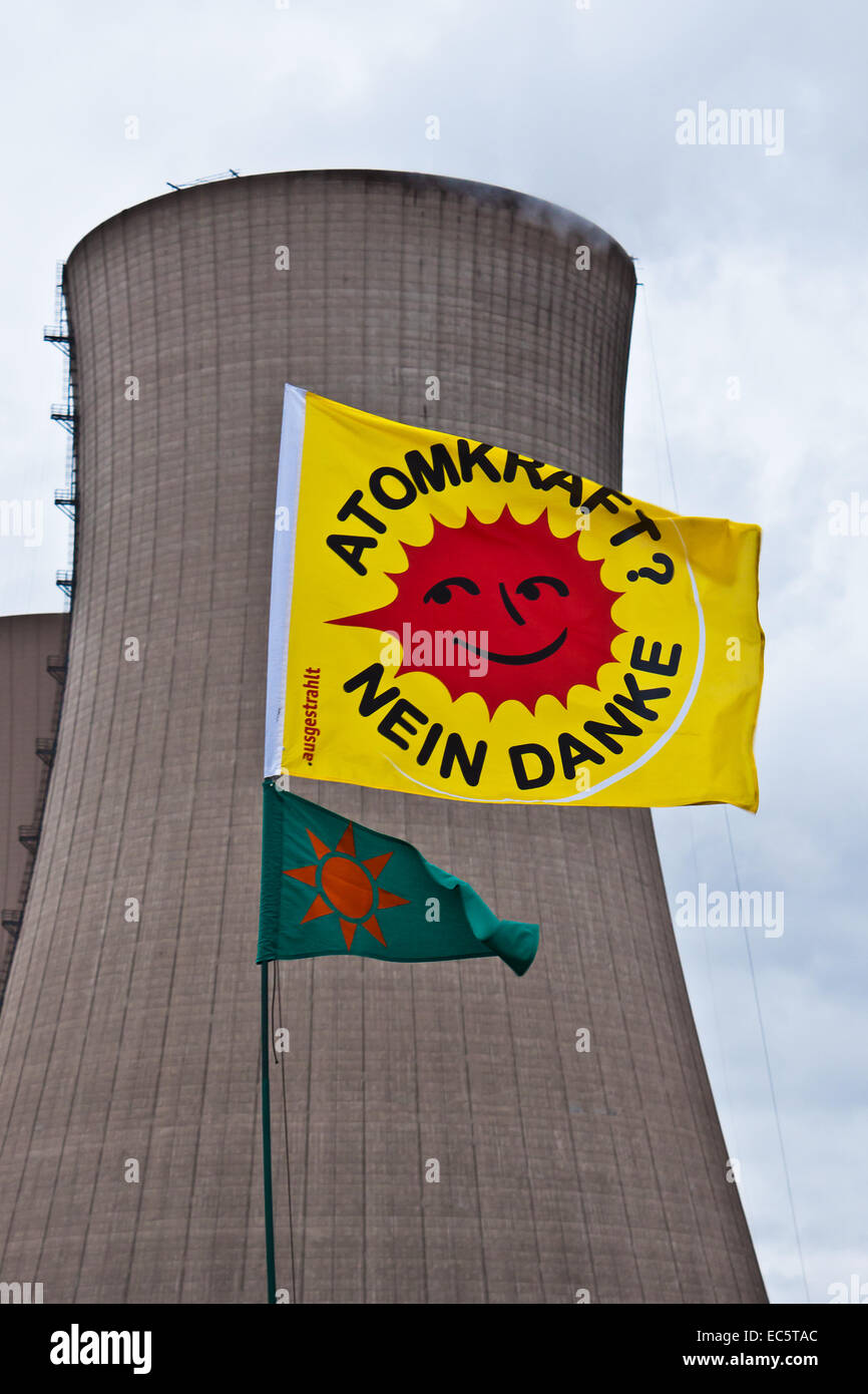 anti-nuclear flag in front of a nuclear power station cooling tower Stock Photo