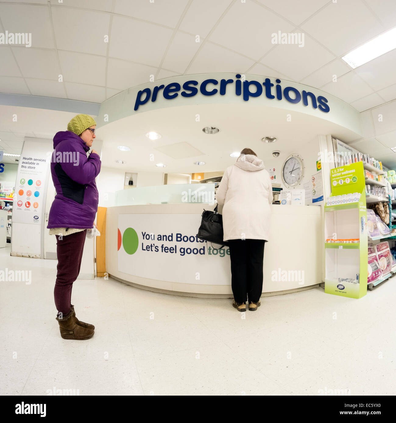 Fisheye shot of Prescriptions counter in a Boots chemist shop, UK. - Stock Image