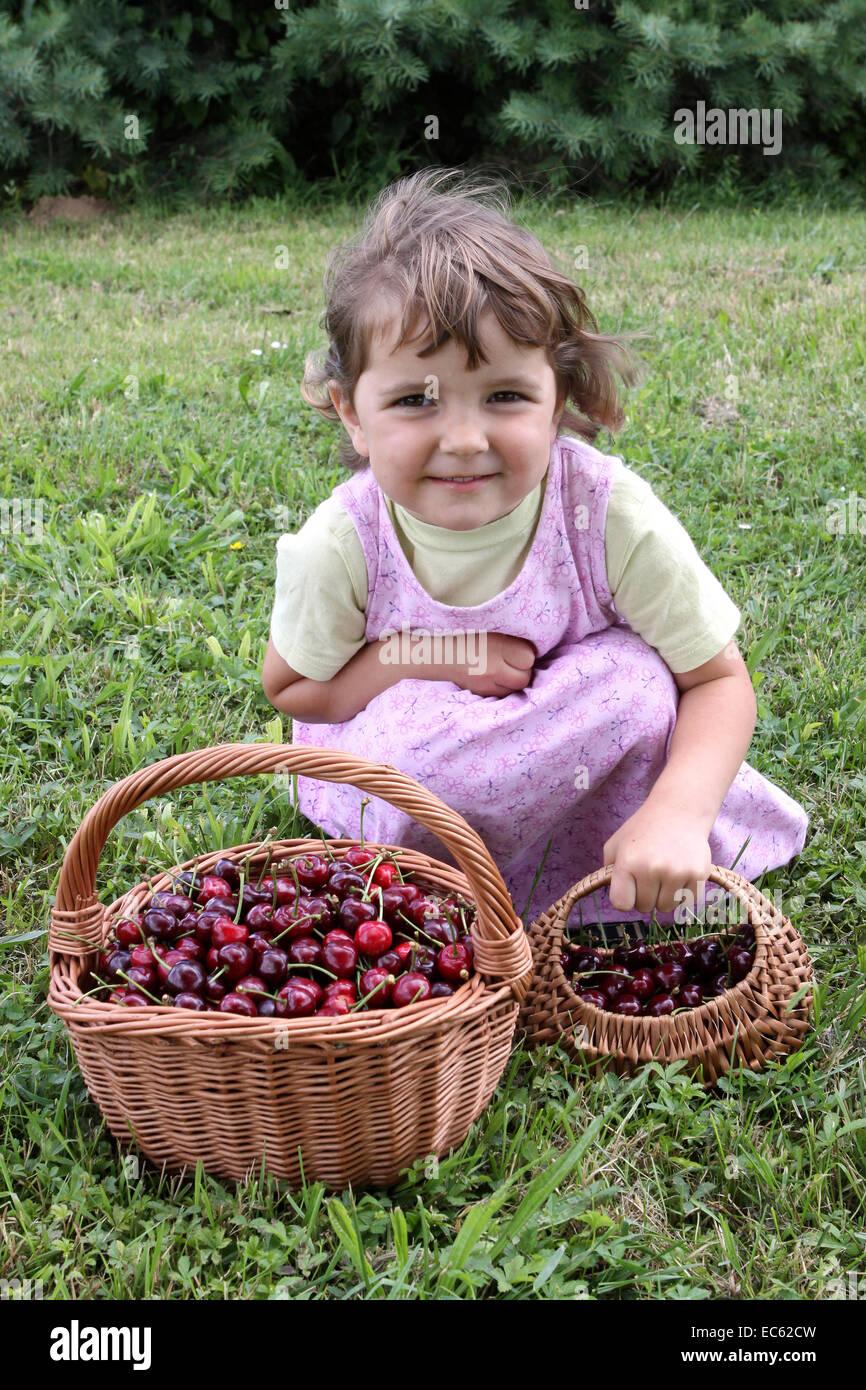 Girl with cherries Stock Photo