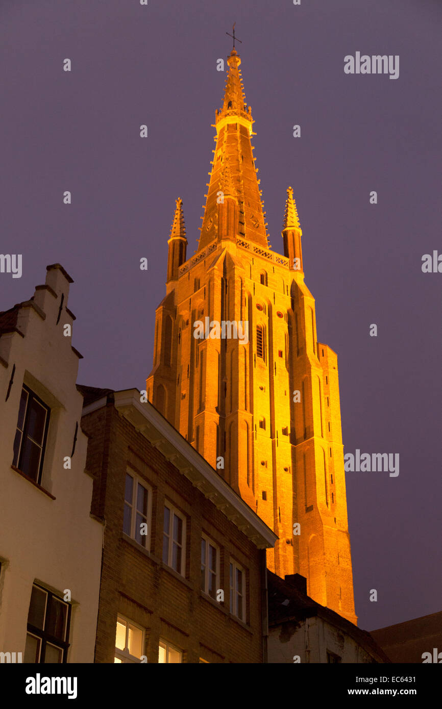The spire of The church of our Lady at dusk, Bruges, Belgium, Europe - Stock Image