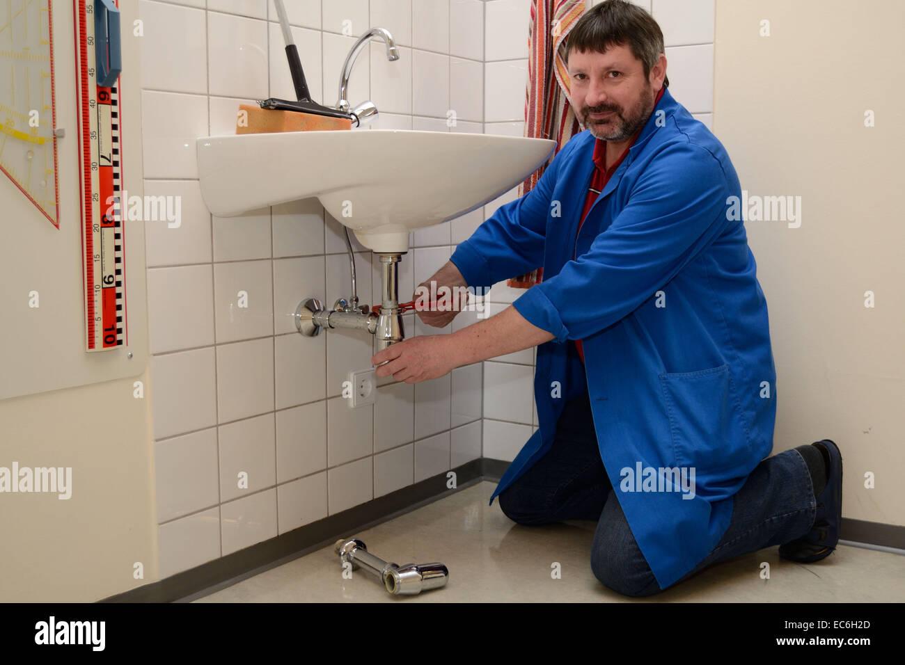 caretaker repaired sink - Stock Image