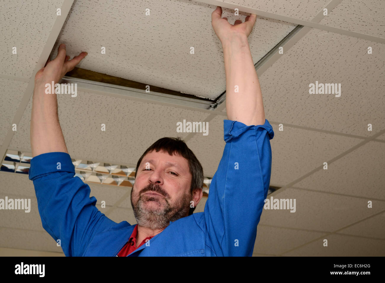 Skilled workers repaired damage - Stock Image