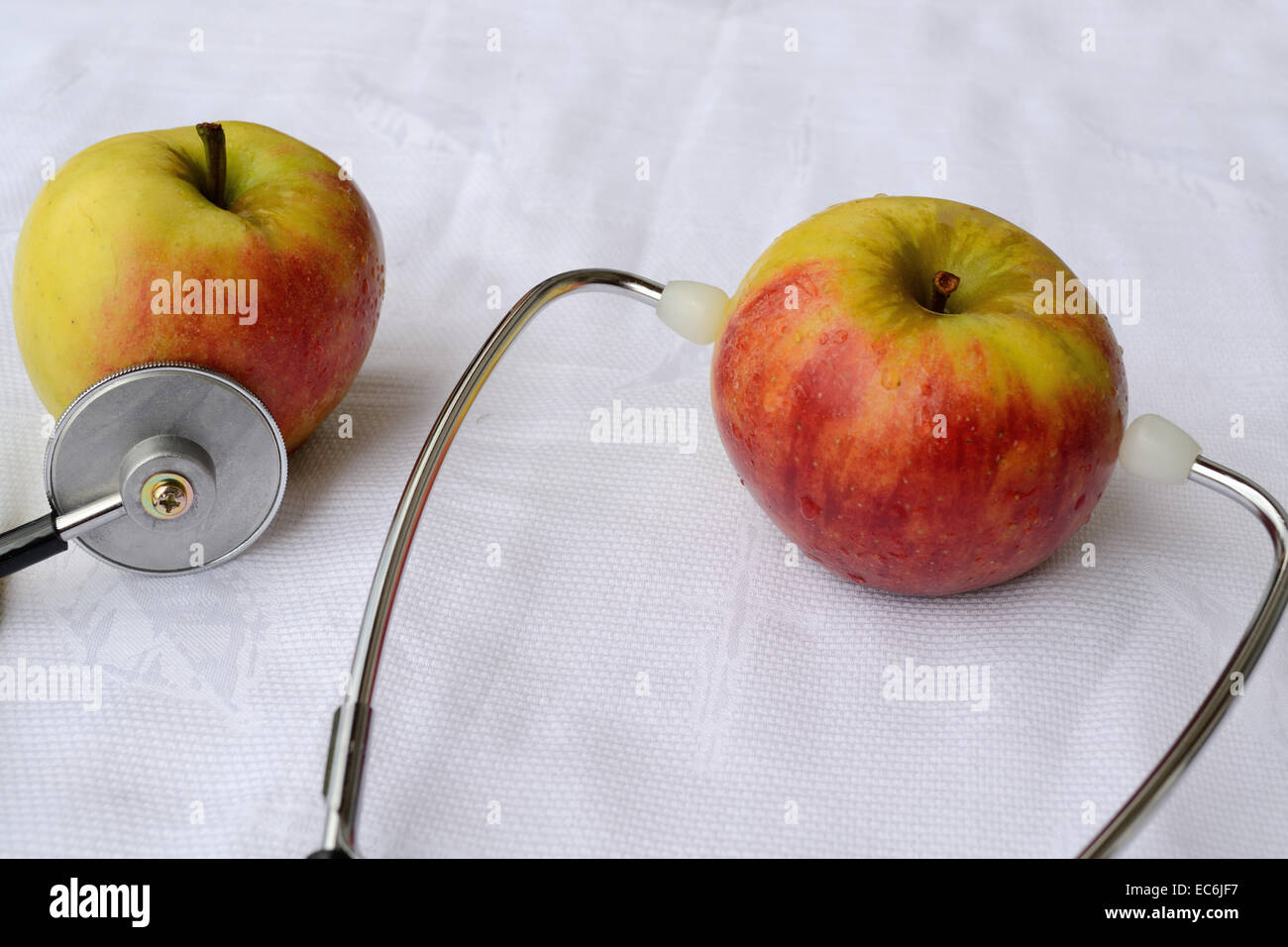 exempted apples with stethoscope - Stock Image