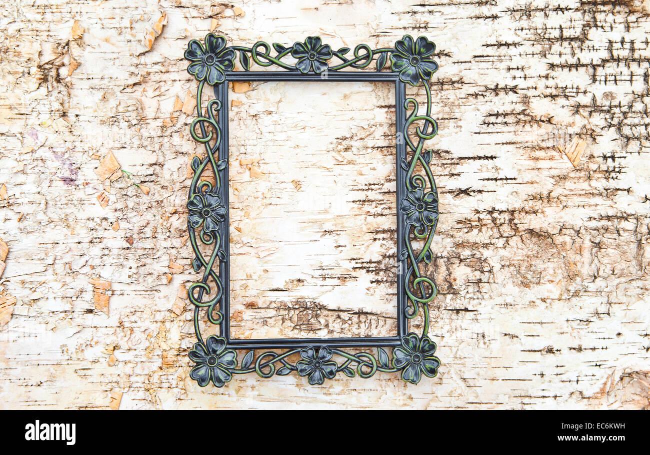 Vintage frame on wooden background - Stock Image