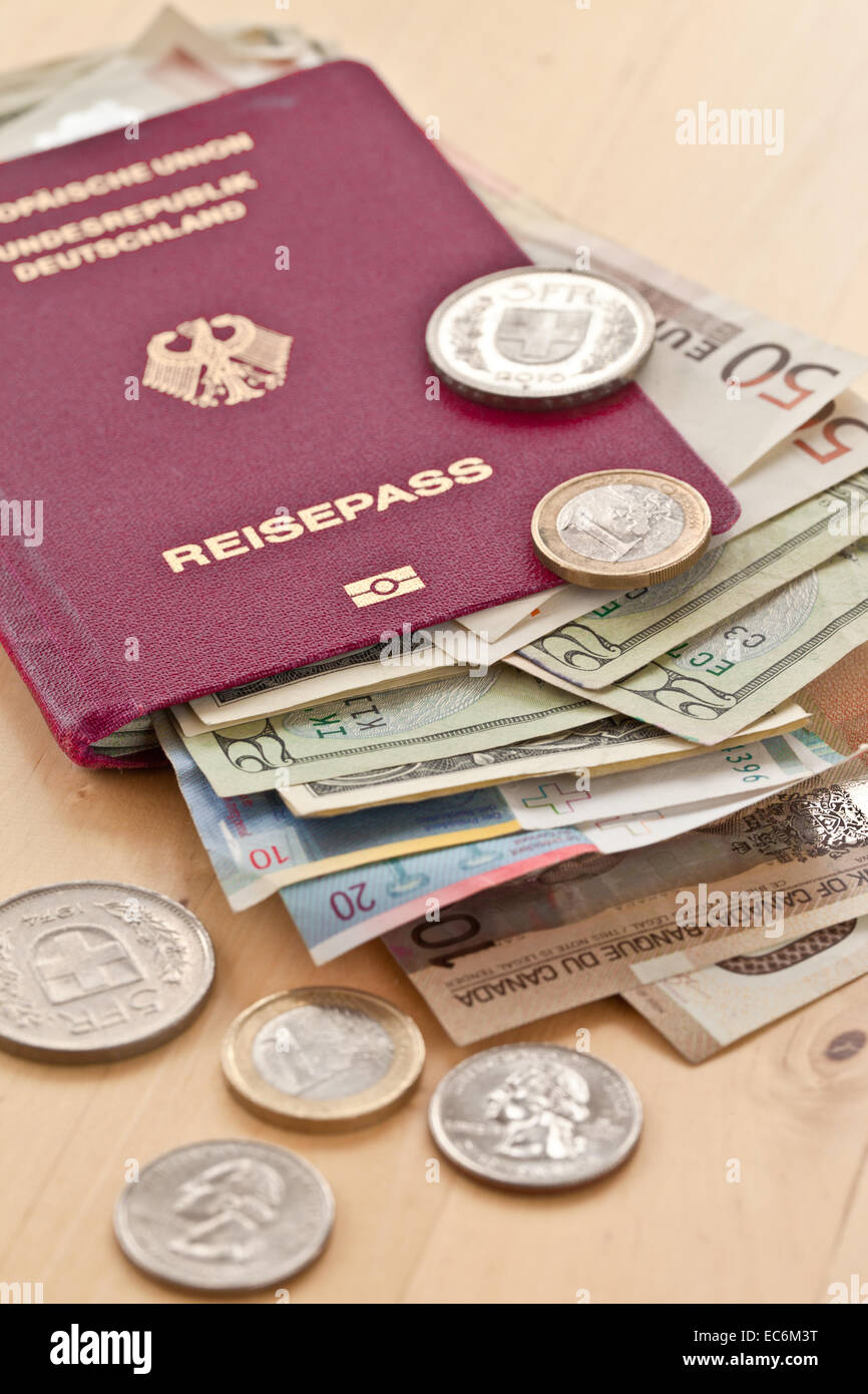 German passport and different currencies - Stock Image