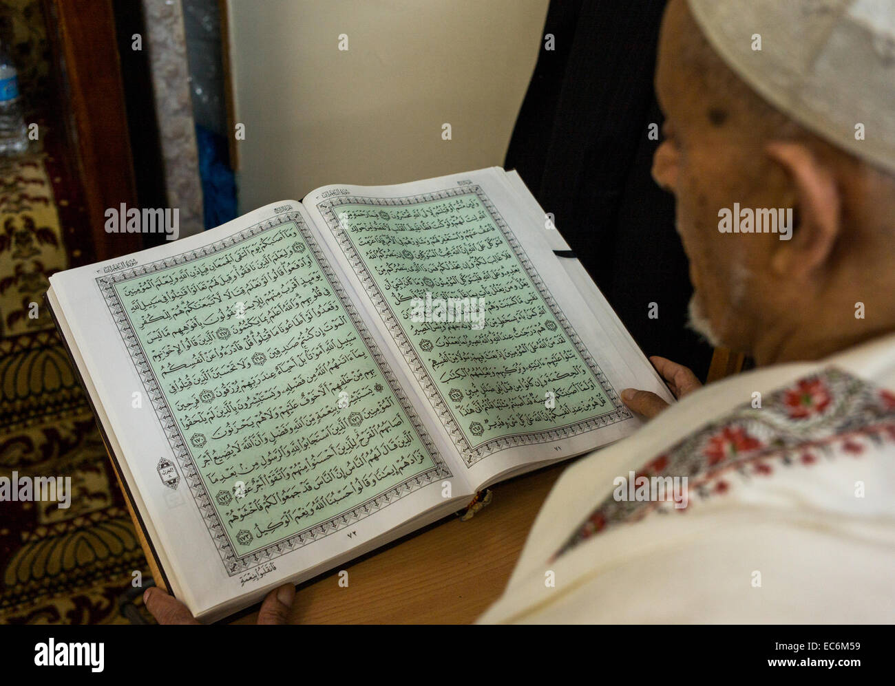 An Arab American Muslim reads the Koran at the Islamic Center of Bay Ridge in Brooklyn New York during the month Stock Photo
