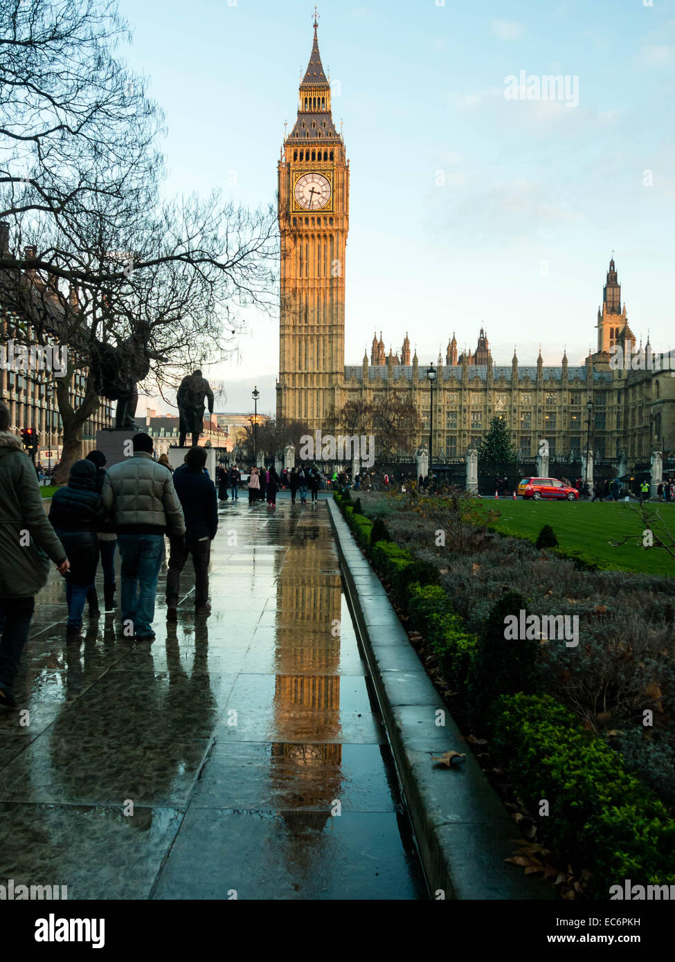 The Elizabeth tower, reflecting on the wet pavements of Parliament square, London, England - Stock Image