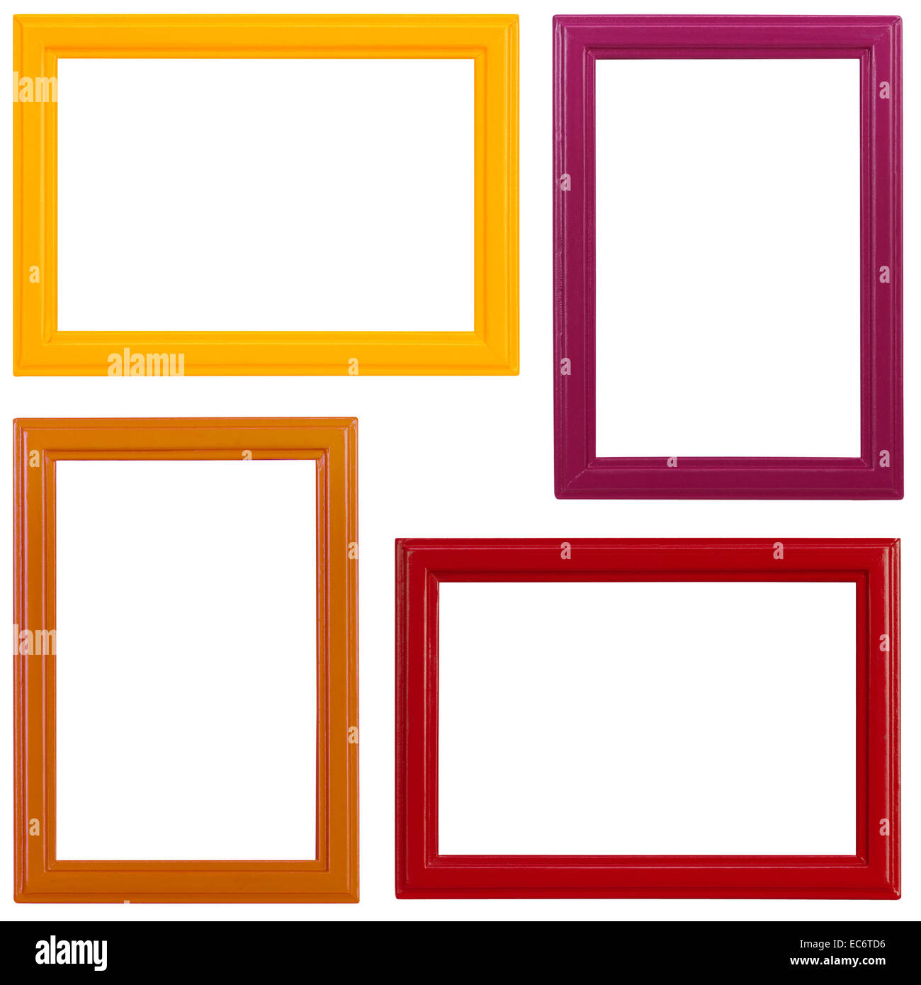 Four different coloured wooden picture frames on white background ...