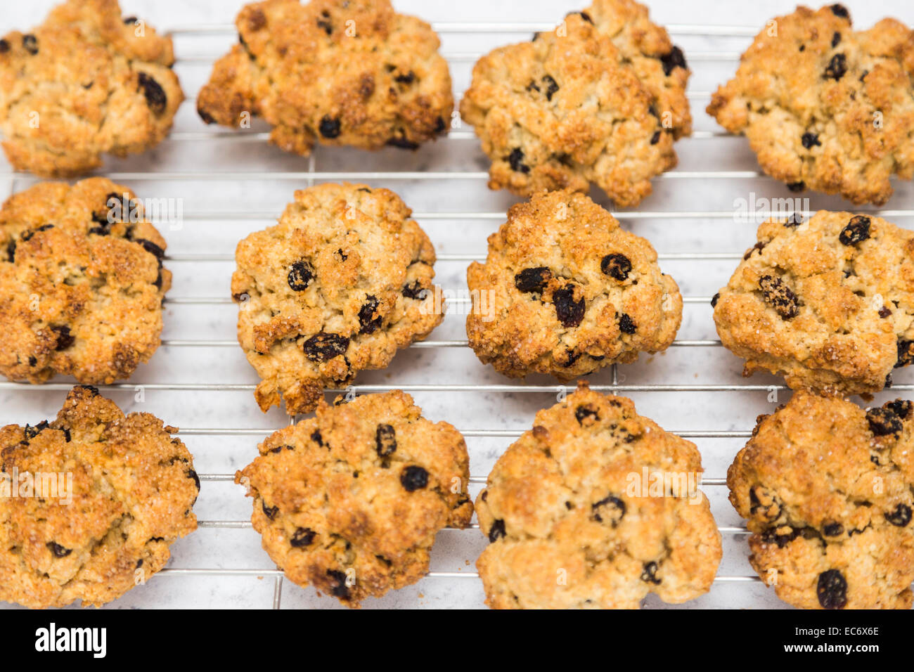 Rock cakes, a traditional British teatime treat, home-baked small fruit cakes made with currents or raisins, on - Stock Image