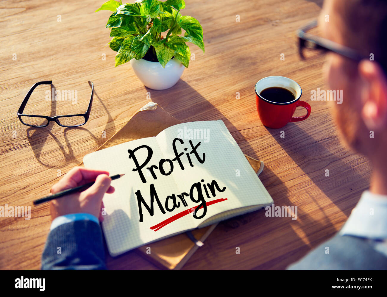Man with a Note and a Word Profit Margin - Stock Image