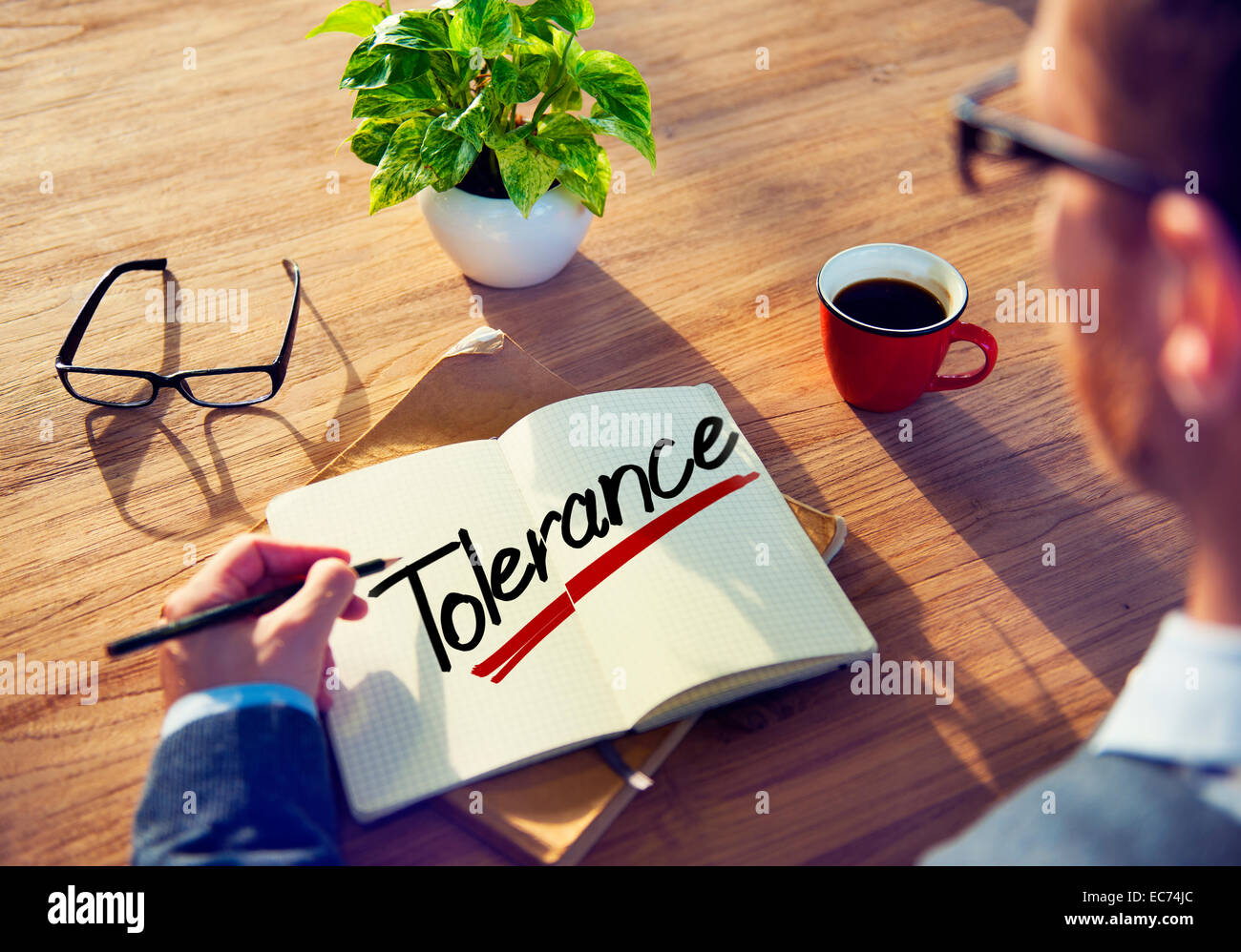 A Man Brainstorming about Tolerance - Stock Image