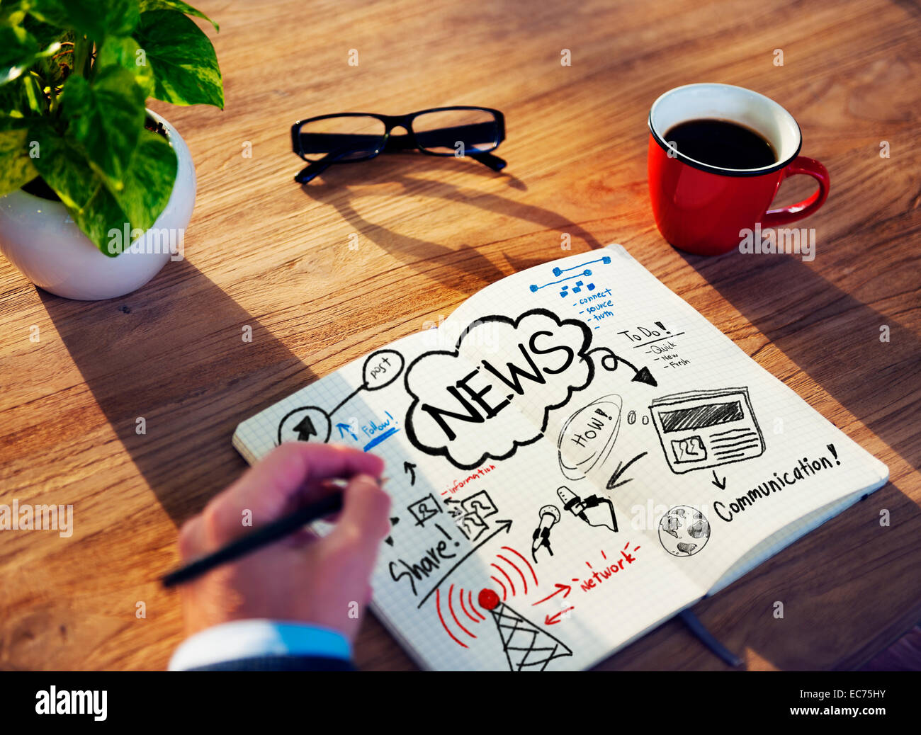 Man Drawing and Working on a News Concept - Stock Image