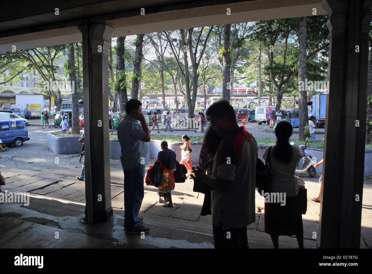 Pedestrians commuting at rush hour in Kandy, Sri Lanka - Stock Image