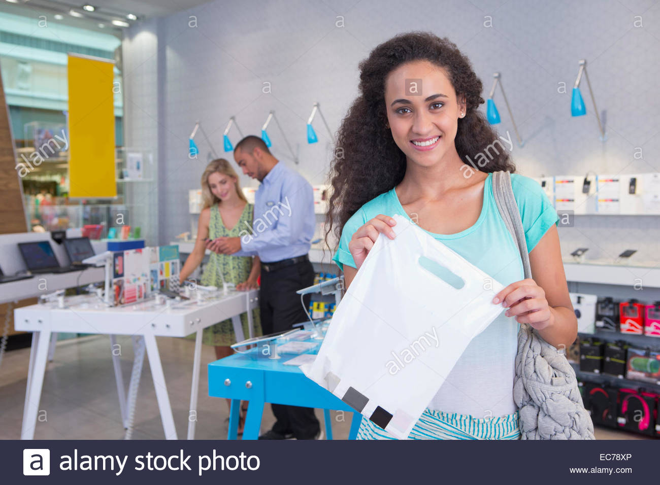 Woman with purchase in phone store - Stock Image