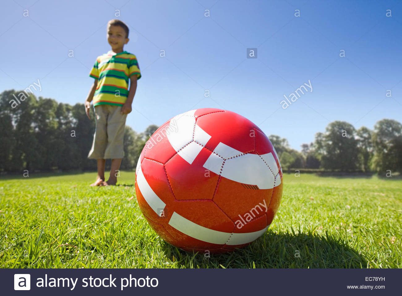 Boy in park with football - Stock Image