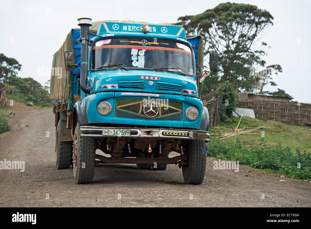 Old model of Mercedes-Benz L-series truck on an all-weather road crossing Bale Mountains, Ethiopia - Stock Image