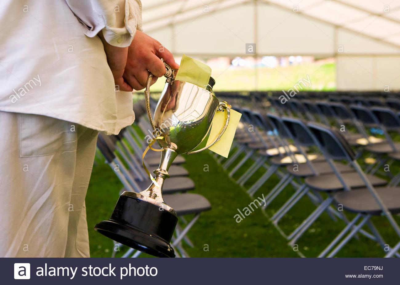 Judge at show holding a trophy - Stock Image