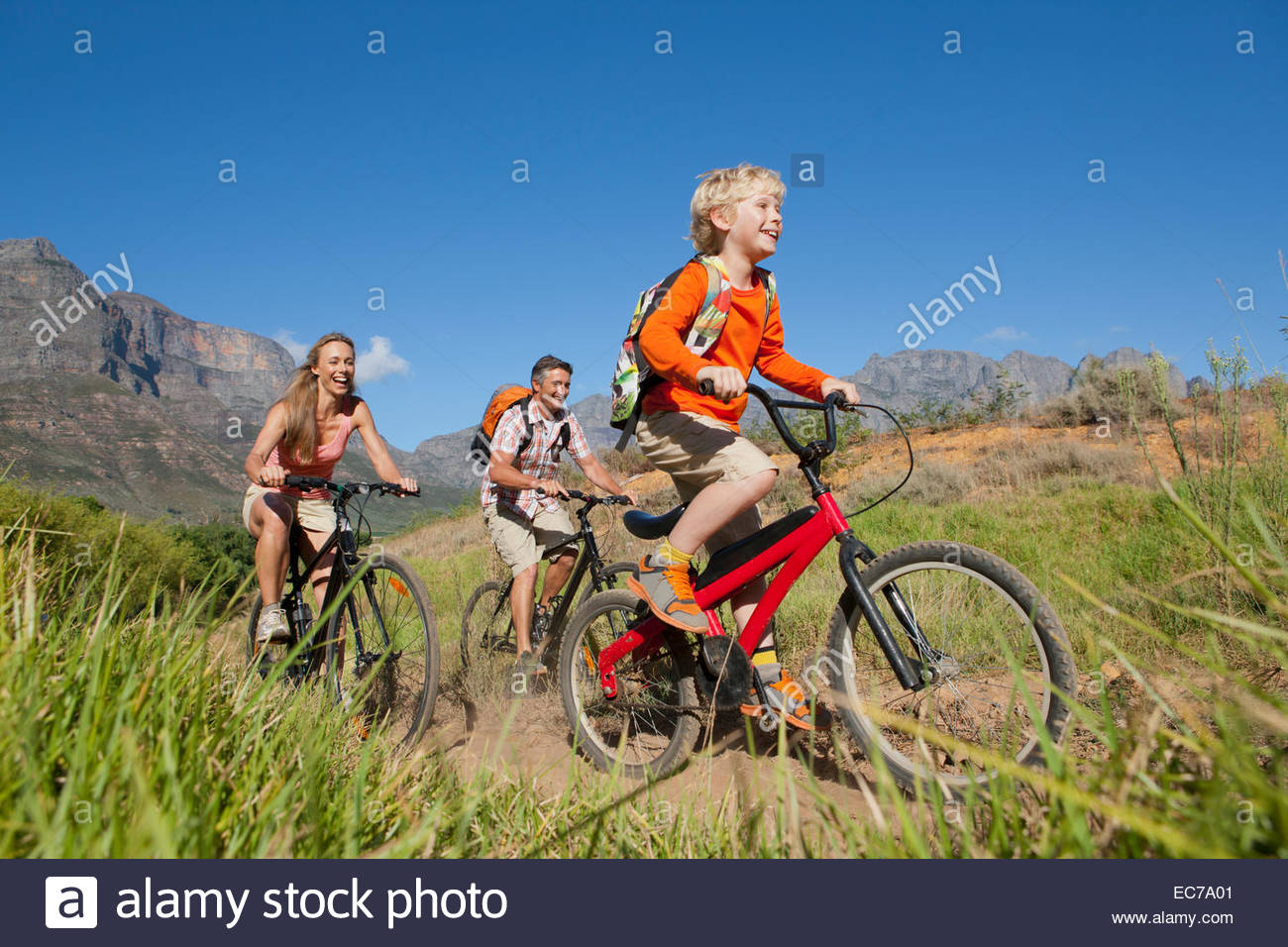 Family mountain biking on country track - Stock Image