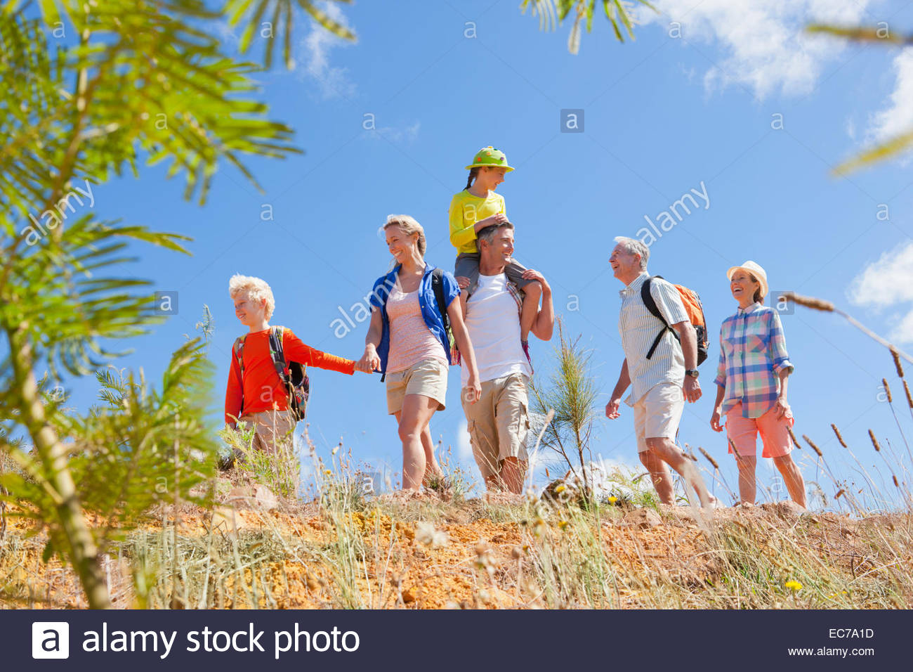 Multi generation family hiking in countryside - Stock Image