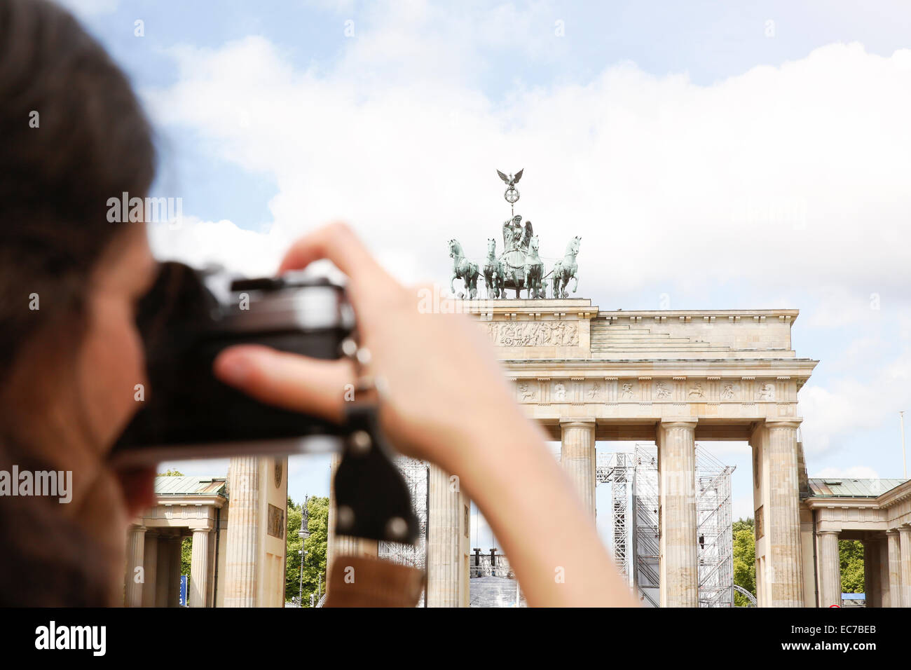Germany, Berlin, female tourist photographing Brandenburg Gate - Stock Image