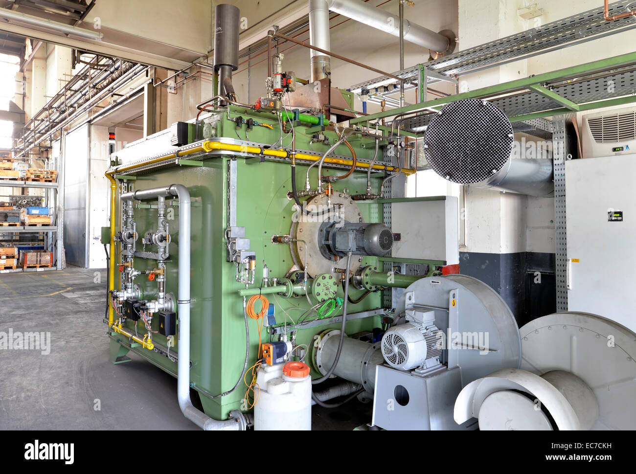 Process engineering machine in a factory hall - Stock Image