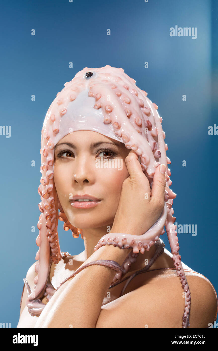 Portrait of woman wearing octopus headdress - Stock Image