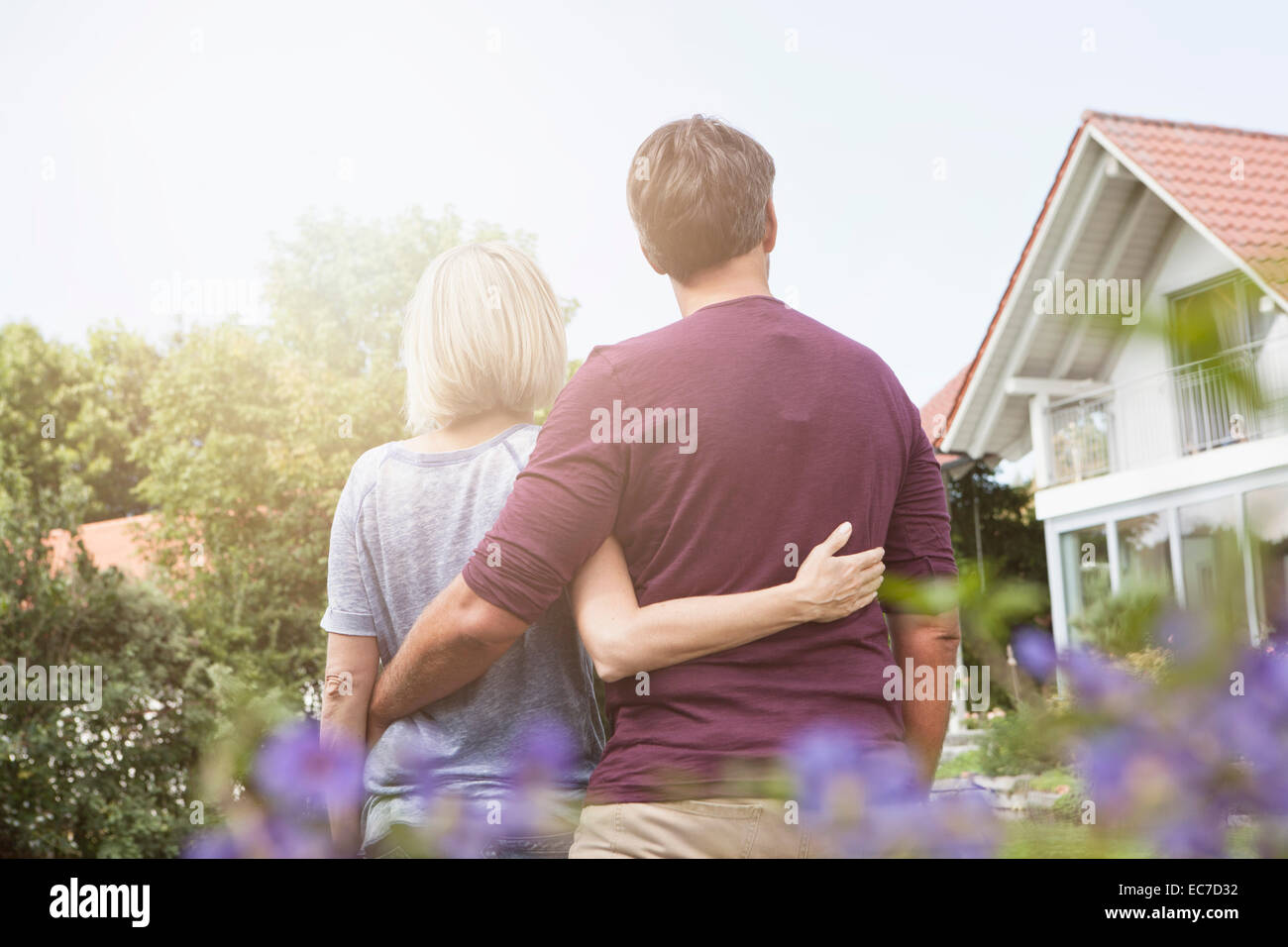 Rear view of mature couple in garden - Stock Image