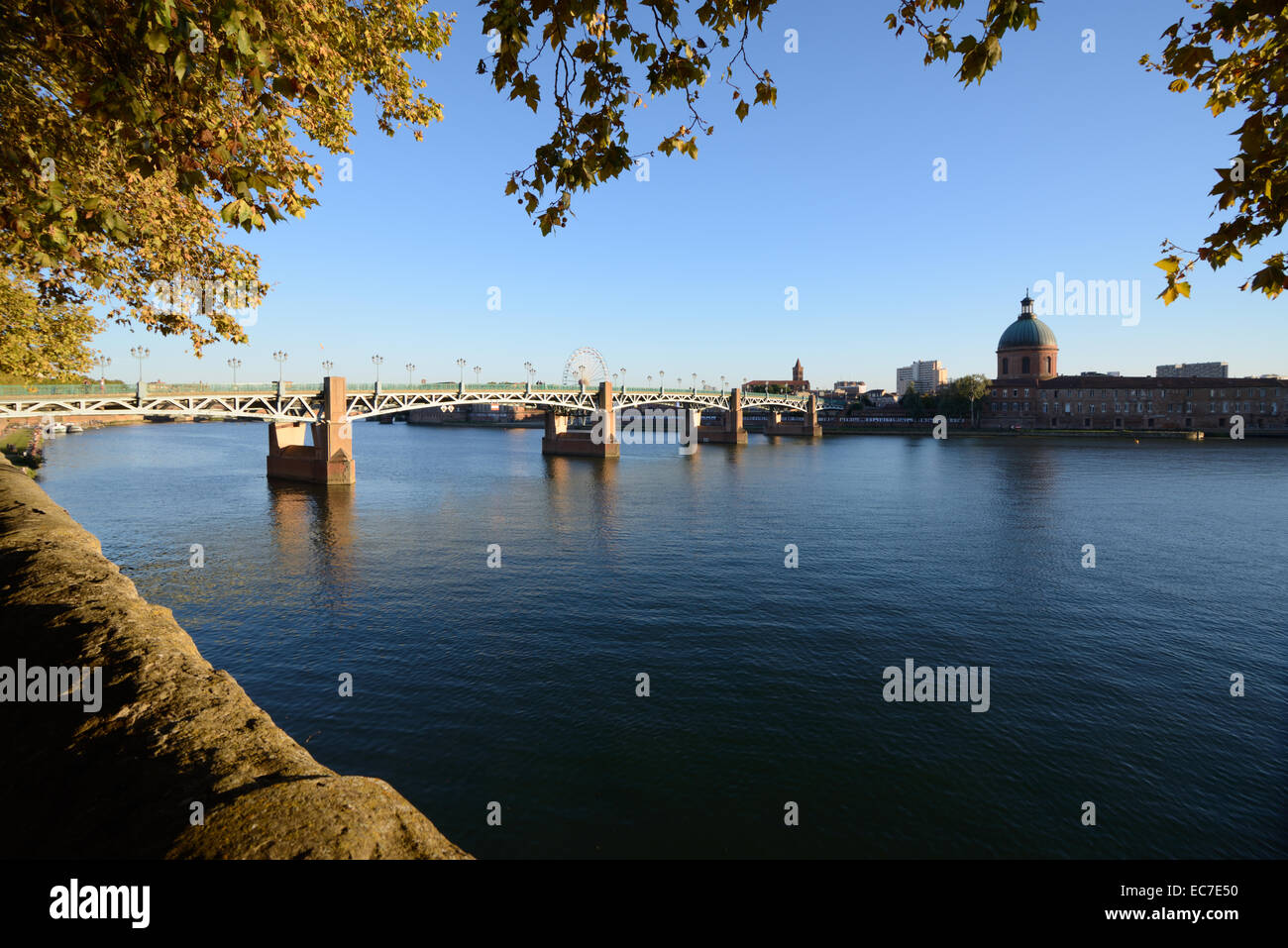 River Garonne and Pont Saint Pierre Bridge with Dome of Saint Joseph Chapel Toulouse Haute-Garonne France - Stock Image