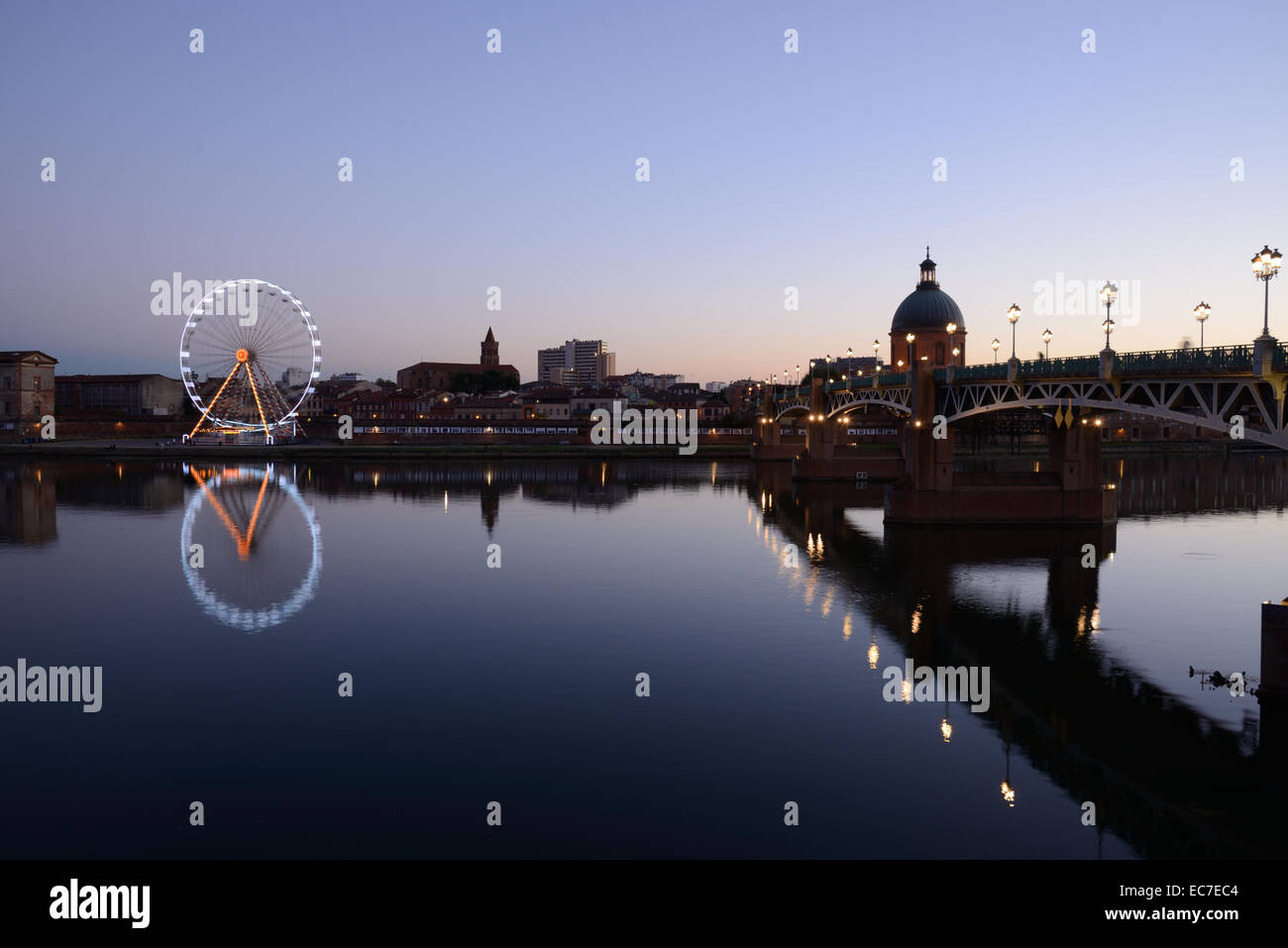 River Garonne & Pont Saint Pierre Bridge & Saint Joseph's Dome at Dusk Night or Evening Toulouse Haute-Garonne France Stock Photo