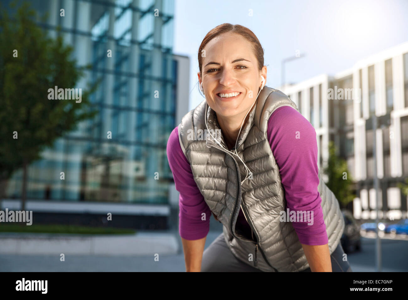 Smiling athletic woman outdoors - Stock Image