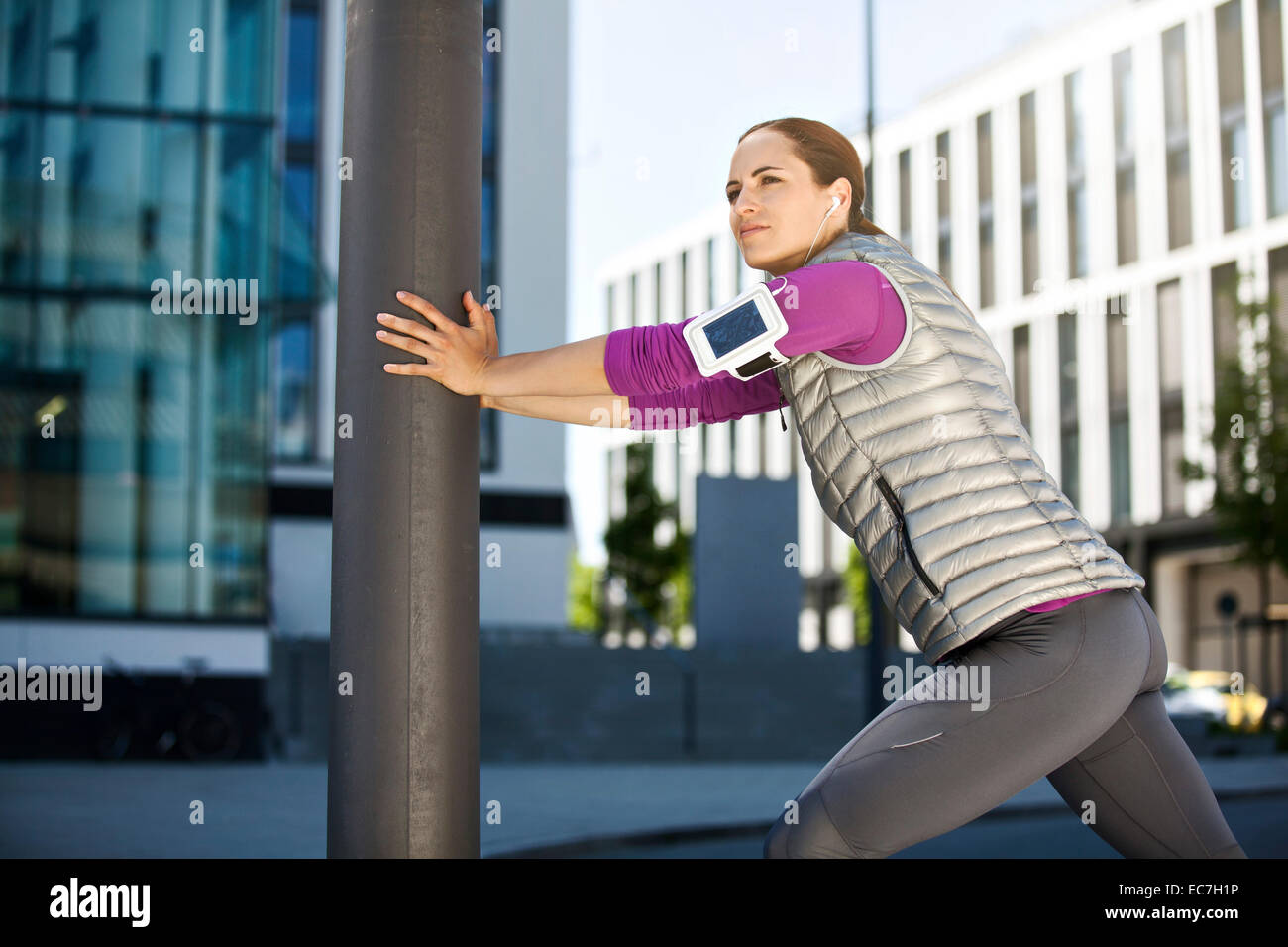 Athletic brunette woman outdoors - Stock Image