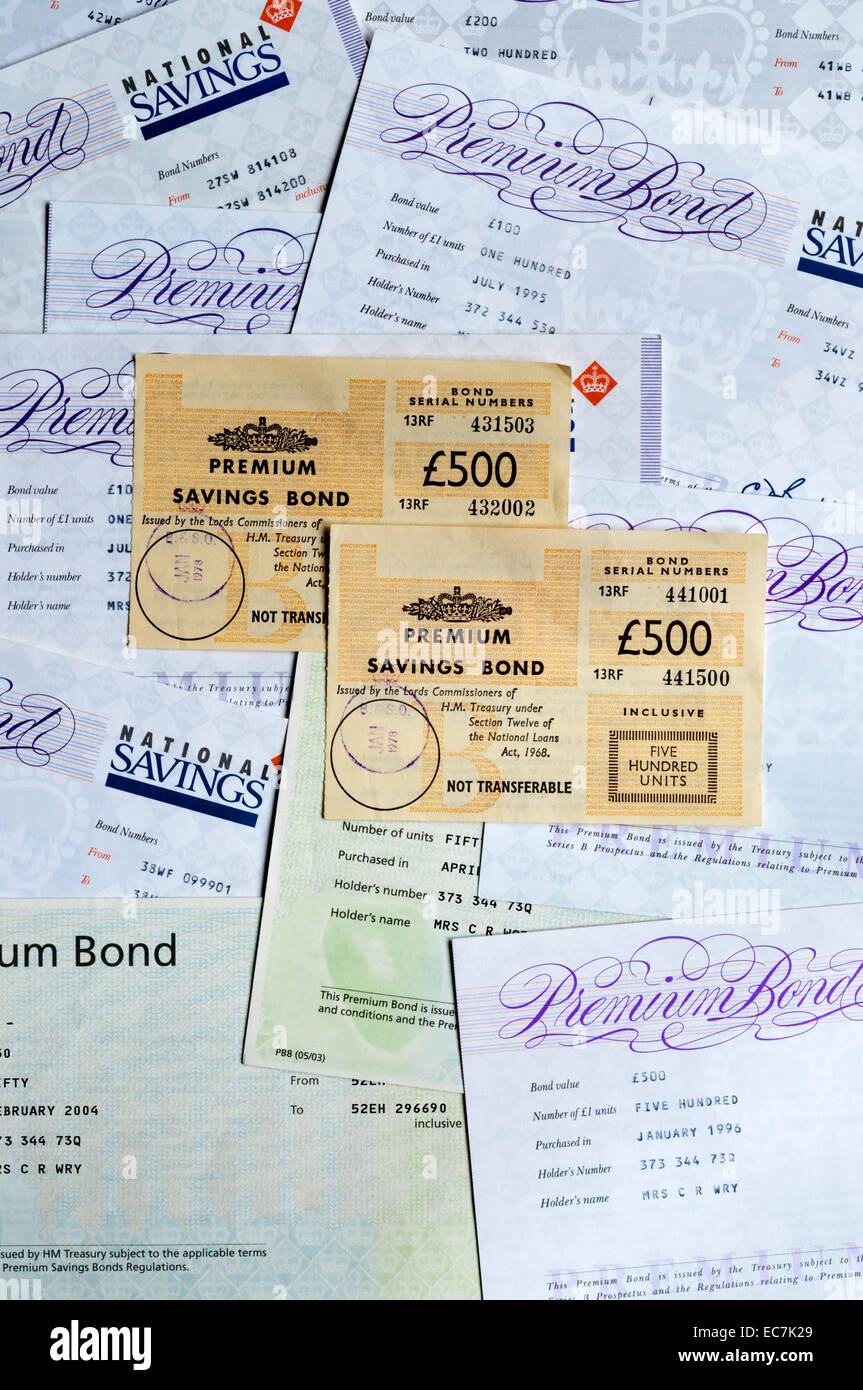 A variety of styles of Premium Savings Bond certificates from 1970s to 2004. Stock Photo