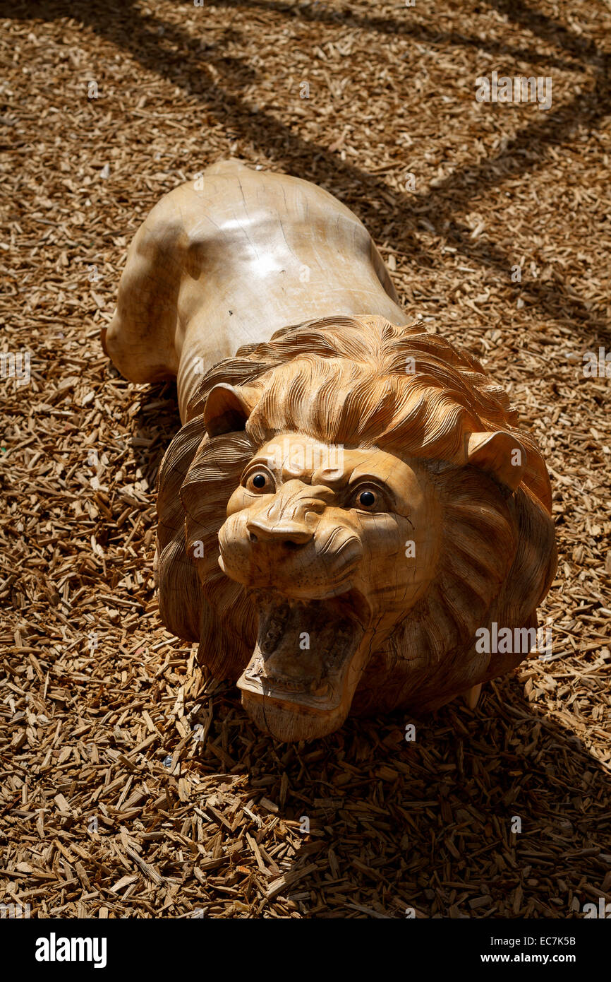 zoo parc beauval wooden carved lion, France. - Stock Image