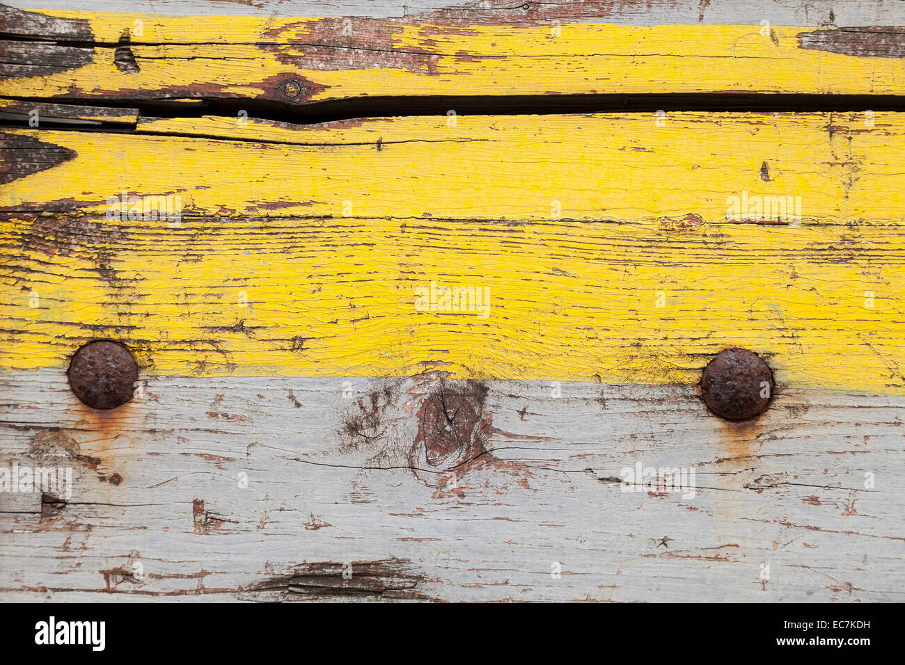 Weathered Wooden Board With Yellow And Grey Paint Close Up