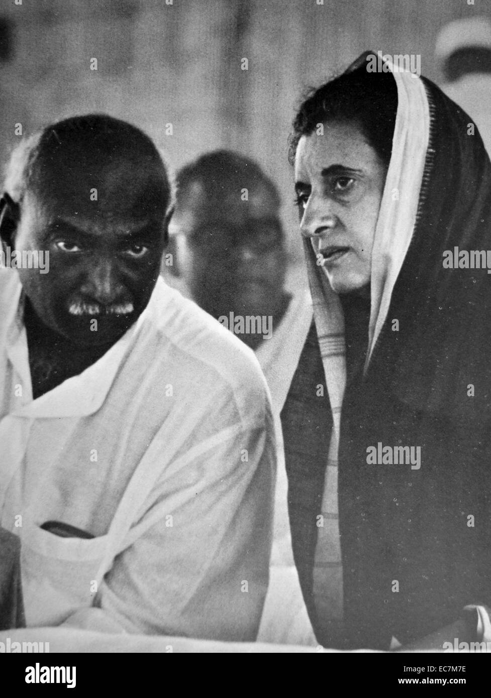 Indira Gandhi Prime Minister of India speaks with a Congress party colleague. - Stock Image