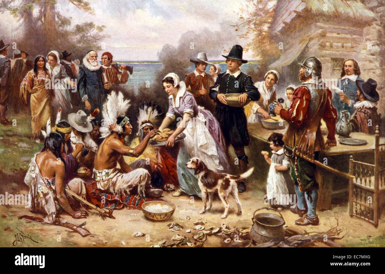 The first Thanksgiving 1621. Pilgrims and Natives gather to share meal. - Stock Image