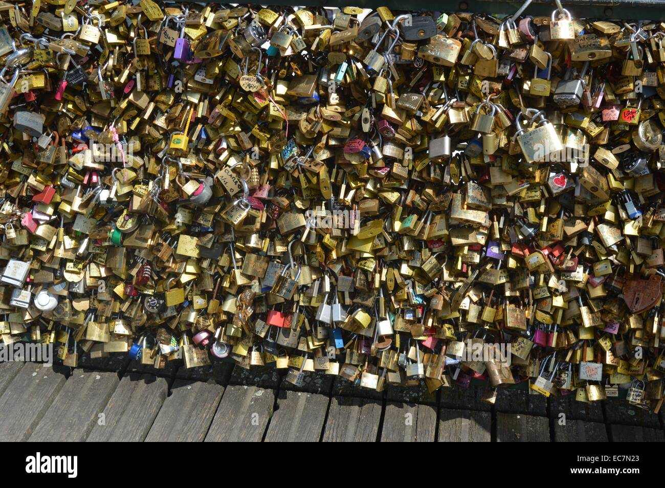The Pont des Arts bridge in Paris with attached padlocks (love locks) - Stock Image