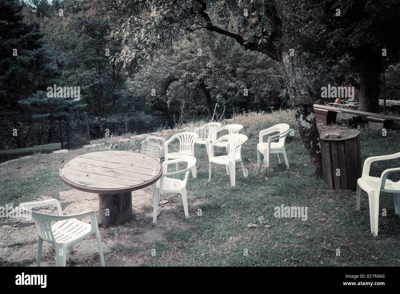 outdoors table chairs absence - Stock Image