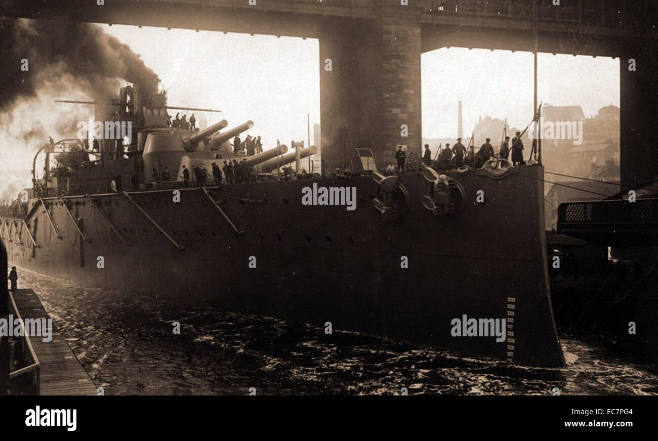Photograph of the newly-completed super-dreadnought HMS Monarch steaming down the River Tyne. Dated 1911 - Stock Image